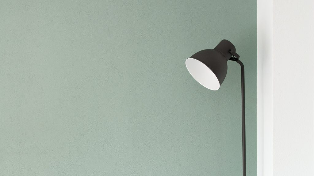 minimalist lamp design green wall black lamp