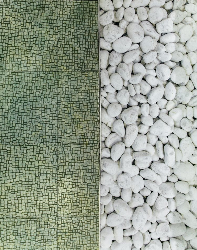 green patterned floor with white pebble