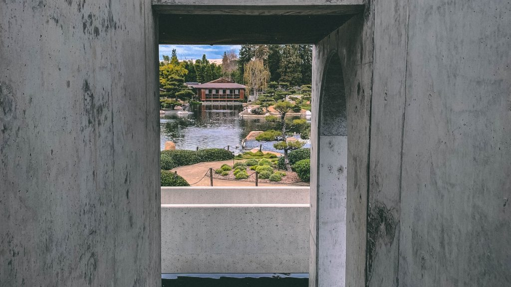japanese garden view through a cement architecture