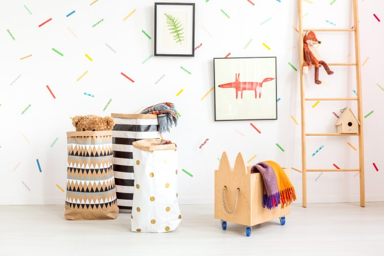Child room with toy bags and wooden box