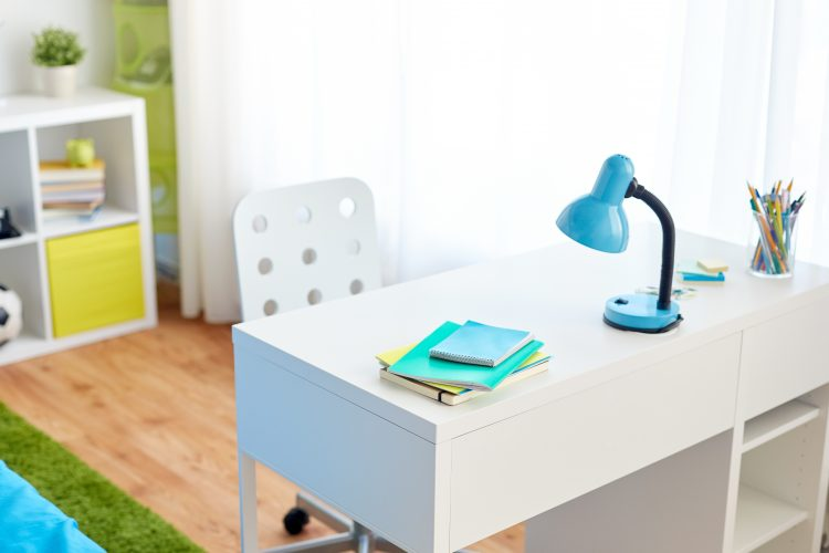 interior, education and furnishing concept - kids room with table and school staff at home