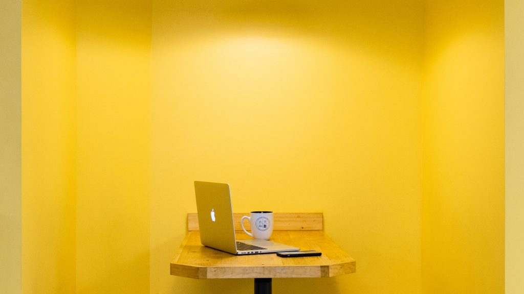 sitting benches with yellow walls